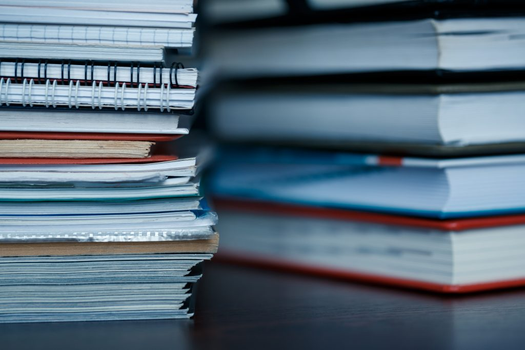 Stacks of various types of reports