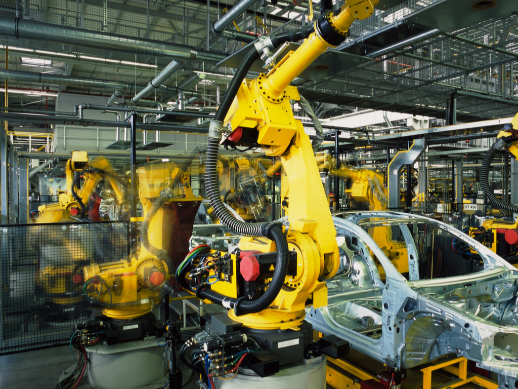 Robots in car assembly facility